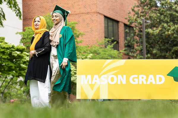 Graduates attend the Patriot Procession with friends and family at Mason Pond.  Photo by:  Ron Aira/Creative Services/George Mason University