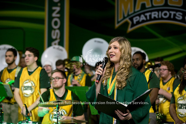 Ashlyn Rock, a soprano graduating today with a bachelor of music in vocal performance, sings the national anthem and the alma mater during the 2018 Winter Graduation at the Fairfax Campus.  Photo by Bethany Camp/Creative Services/George Mason University