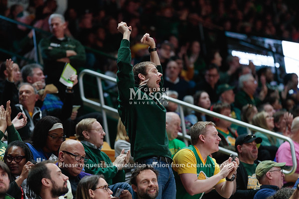 Students cheer during the Men's Basketball Homecoming 2020 game against Saint Joseph's. Photo By Ian Shiff/Creative Services/George Mason University