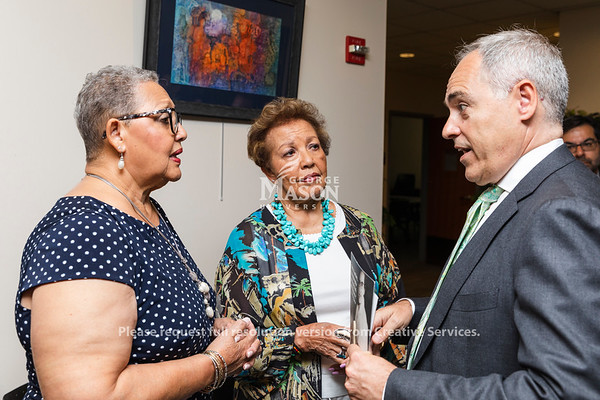 Daughters of NASA mathematician Katherine Johnson, Katherine Moore and Joylette Hylick talk with George Mason University President Ángel Cabrera before a dedication ceremony renaming Bull Run Hall to Katherine G. Johnson Hall on George Mason's Science and Technology Campus. Photo by Lathan Goumas/Strategic Communications