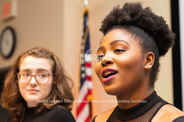 Joi Harper sings as part of a choir during a dedication ceremony renaming Bull Run Hall on George Mason's Science and Technology Campus to Katherine G. Johnson Hall in honor of the NASA mathematician. Photo by Lathan Goumas/Strategic Communications