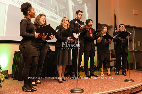 A choir group made of George Mason University students, alumni and faculty sing during a dedication ceremony renaming Bull Run Hall on George Mason's Science and Technology Campus to Katherine G. Johnson Hall in honor of the NASA mathematician. Photo by Lathan Goumas/Strategic Communications