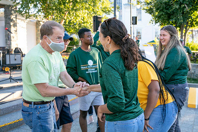 Activities at Mason Rock the Block included Mason give-away tables, victory at the Annual Challenge Cup Corn Hole game and President Washington receiving the Key to the City. Photo by: Shelby Burgess/Strategic Communications/George Mason University