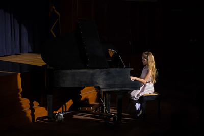 Ava Milani playing the piano