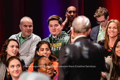 """Wearing a George Mason sweatshirt, incoming student Ethan Schoenberg listens to Democratic Presidential candidate Mayor Michael Bloomberg during a Fox News town hall at George Mason University's Hylton Performing Arts Center. """"I'm voting tomorrow and I wanted to be more informed,"""" Schoneberg, adding, """"he was very confident.""""  Photo by Lathan Goumas/ Office of Communications and Marketing.  Photo taken Monday, March 02 2020"""