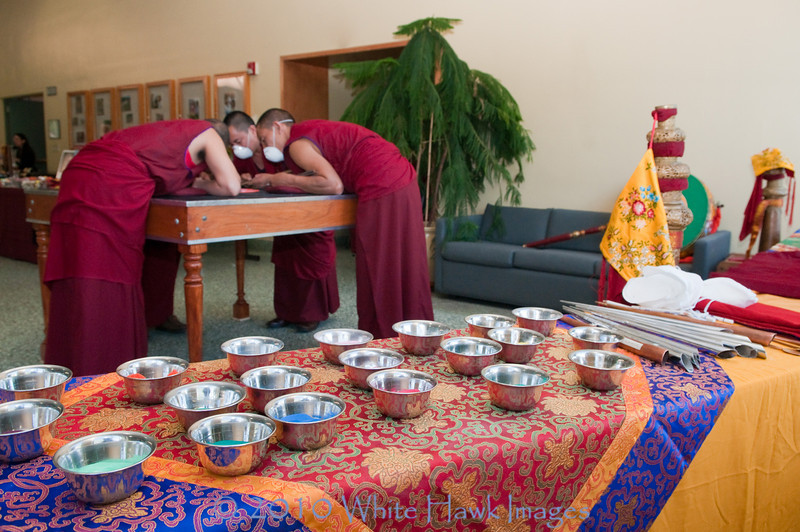 Tibetan Monks from Drepung Loseling Monastery create sacred sand mandala, at Bastyr University