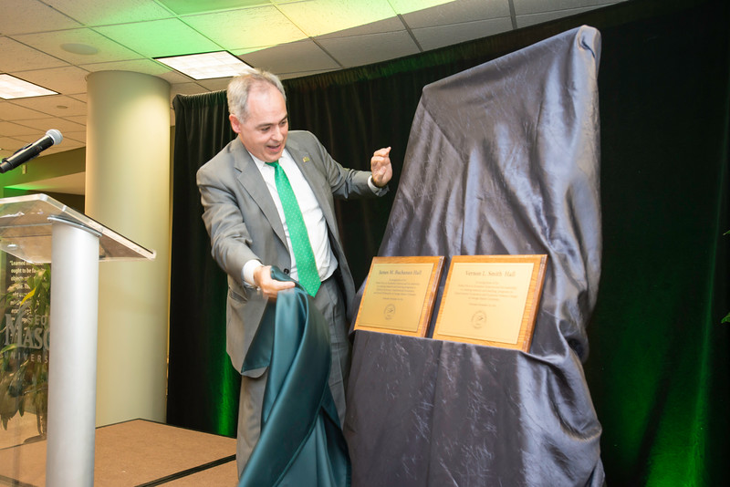 Ángel Cabrera, president, unveils plaques at the James M. Buchanan and Vernon L. Smith Dedication at George Mason University Arlington Campus.  Photo by:  Ron Aira/Creative Services/George Mason University