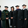 Provost and Executive Vice President S. David Wu, President Ángel Cabrera, Petula C. Metzler Judge, Prince William General District Court, and Board of Visitors Rector Tom Davis at Winter Graduation 2017. Photo by Bethany Camp/Creative Services/George Mason University