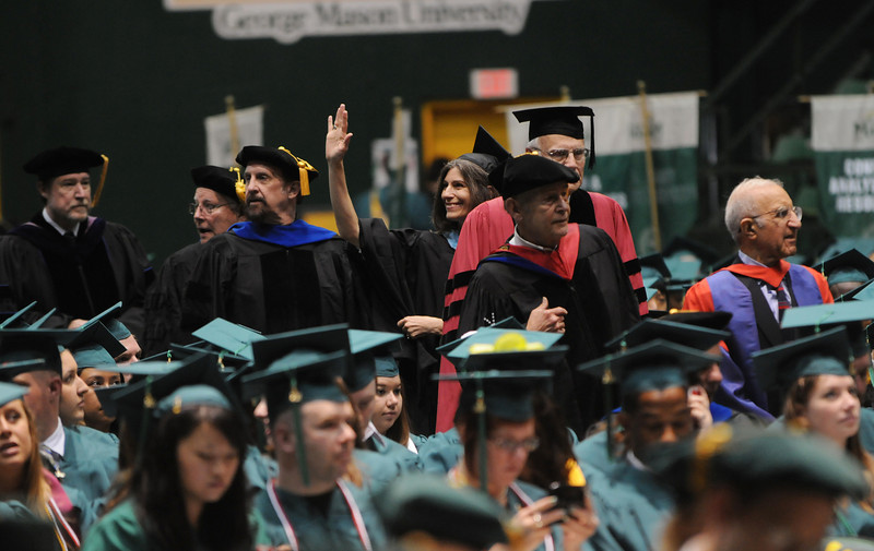 Alumni Affairs Associate Vice President Chris Clark-Talley waves to graduates. Photo by Evan Cantwell