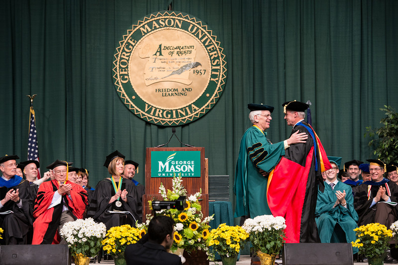 Dean of the Volgenau School of Engineering Lloyd Griffiths hugs Alan Merten at Commencement 2012. Photo by Alexis Glenn/Creative Services/George Mason University