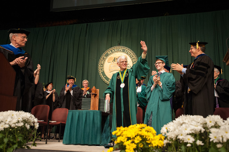Faculty give a standing ovation to Alan Merten at Commencement 2012. Photo by Alexis Glenn/Creative Services/George Mason University