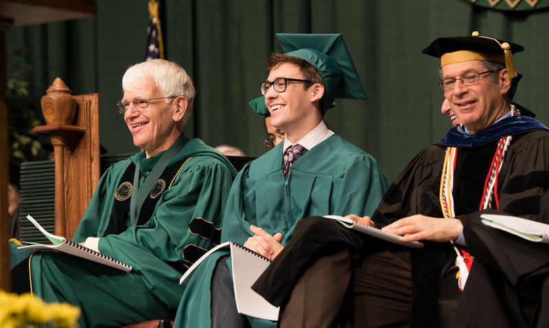 Alan Merten and student Nicolas Cox on stage at Commencement 2012. Photo by Alexis Glenn/Creative Services/George Mason University