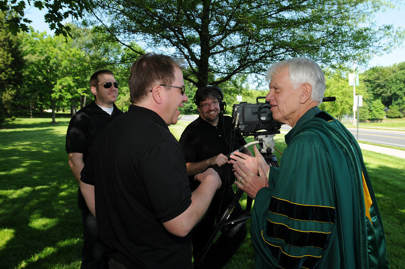 Alan Merten speaking to GMU-TV camera crew at Commencement 2012. Photo by Evan Cantwell/Creative Services/George Mason University