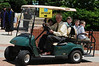 Alan Merten with grandchildren on a golf cart after the Commencement ceremony 2012. Evan Cantwell/Creative Services/George Mason University