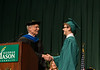 Ernst Volgenau shakes hands with Nicholas Cox at Commencement 2012. Photo by Alexis Glenn/Creative Services/George Mason University