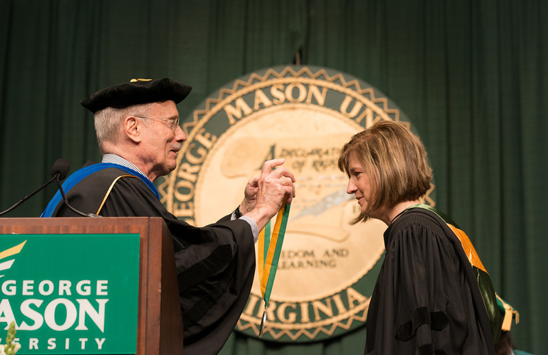 Ernst Volgenau presents the Mason Medal to Lovey L. Hammel at Commencement 2012. Photo by Alexis Glenn/Creative Services/George Mason University