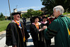 President Alan Merten greets faculty during the academic procession. Evan Cantwell/Creative Services/George Mason University
