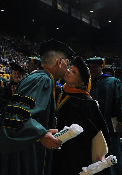 Alan and Sally Merten hugging after the Commencement ceremony 2012. Evan Cantwell/Creative Services/George Mason University