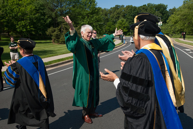 Alan Merten greets faculty at Commencement 2012. Photo by Alexis Glenn/Creative Services/George Mason University