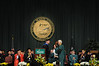 Ernst Volgenau presents the University Mace to Alan Merten at Commencement 2012. Photo by Evan Cantwell/Creative Services/George Mason University