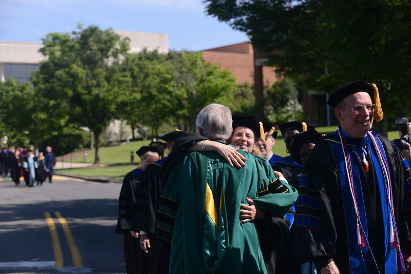 Alan Merten greets faculty during the Academic Procession to kick-off Commencement 2012. Photo by Evan Cantwell/Creative Services/George Mason University