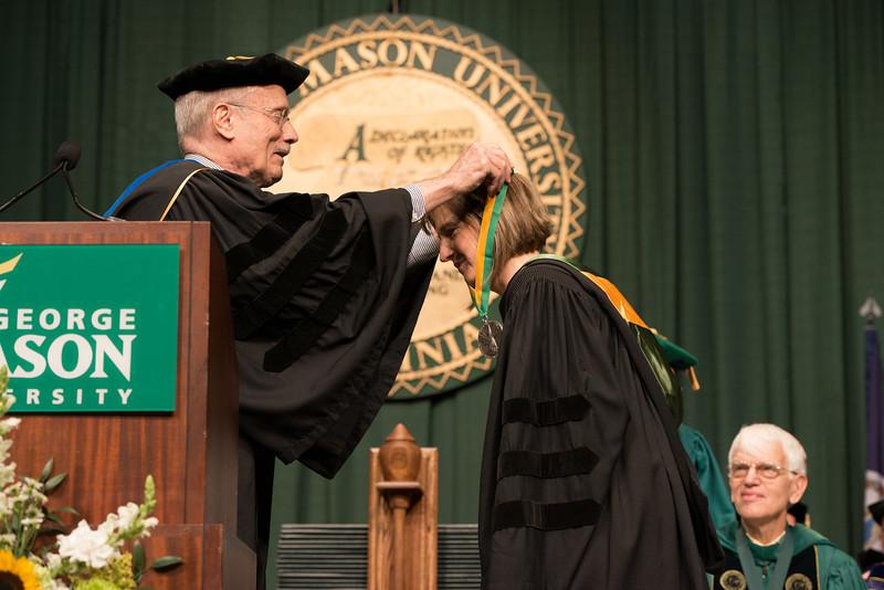 Ernst Volgenau presents the Mason Medal to Lovey L. Hammel at Commencement 2012. Photo by Alexis Glenn/Creative Services/George Mason University