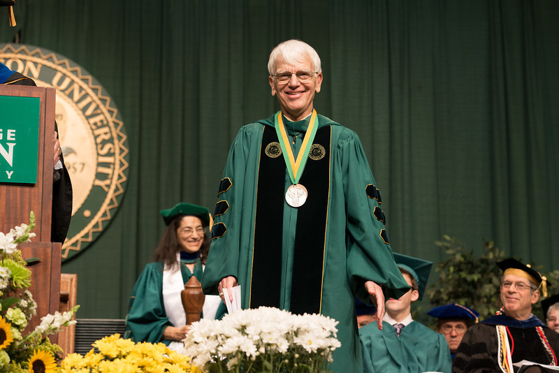 Alan Merten receives the Mason Medal at Commencement 2012. Photo by Alexis Glenn/Creative Services/George Mason University