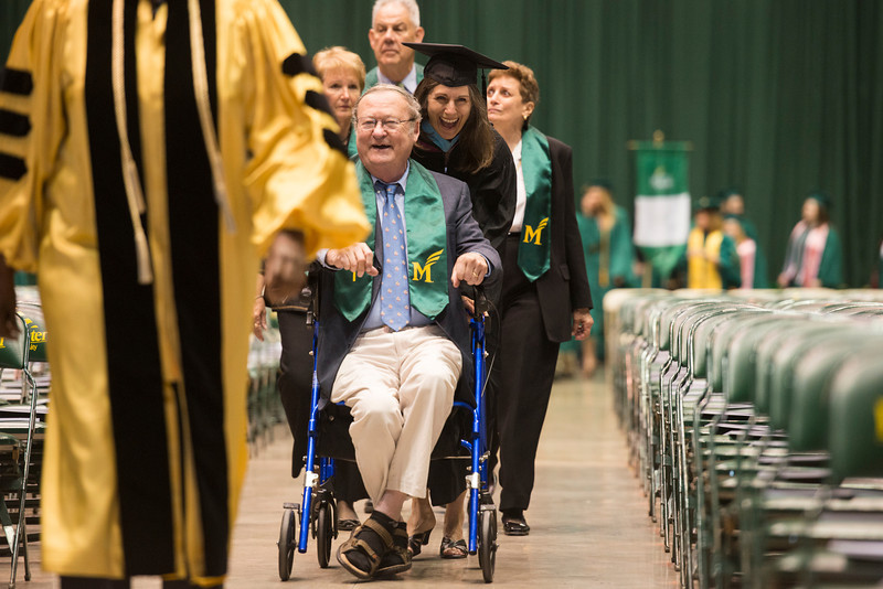 Graduates of the Mason's first class enter the 2013 Commencement ceremony at the Patriot Center. Photo by Alexis Glenn/Creative Services/George Mason University