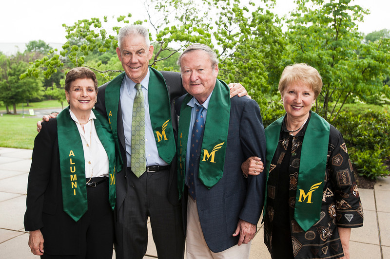 Graduates of the Mason's first class after the 2013 Commencement ceremony. Photo by Alexis Glenn/Creative Services/George Mason University