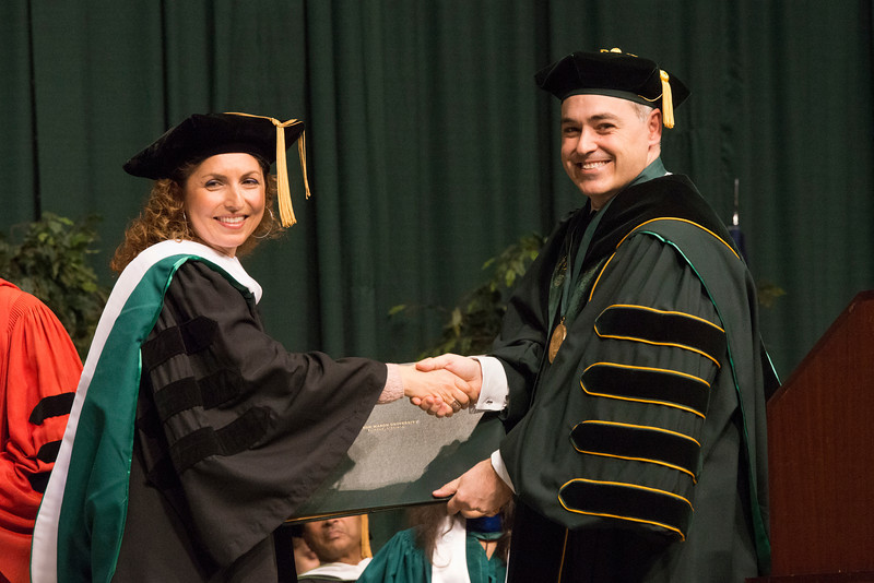 President Ángel Cabrera presents keynote speaker alumna Anousheh Ansari with an honorary degree at the 2012 Winter Convocation. Photo by Alexis Glenn/George Mason University