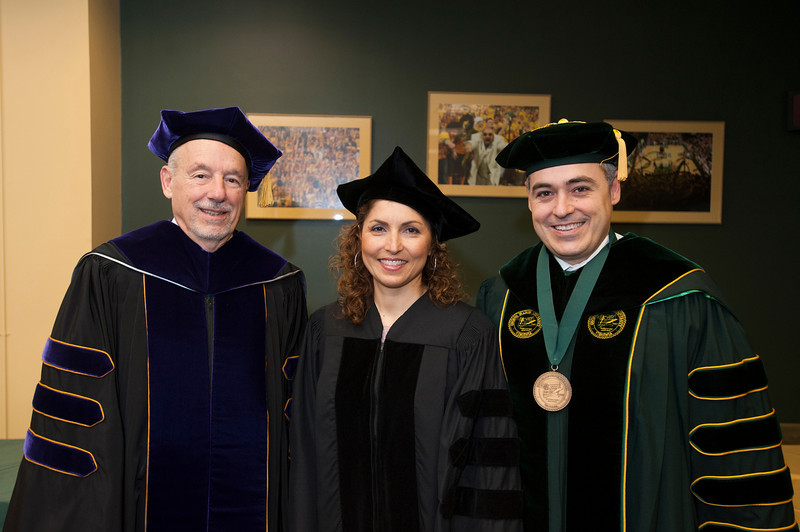 (L to R) Board of Visitors Rector Dan Clemente, keynote speaker alumna Anousheh Ansari, and President Ángel Cabrera attend the 2012 Winter Convocation. Photo by Alexis Glenn/George Mason University
