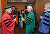 Mason President Dr. Alan Merten and Provost Peter Stearns greet college deans before the Winter Degree Recognition Ceremony at the Mason Inn, Fairfax Campus . Photo by Alexis Glenn/Creative Services/George Mason University