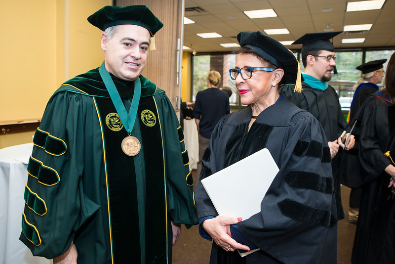 President Ángel Cabrera speaks to Sheila C. Johnson, Co-Founder, BET; CEO, Salamander Hotels & Resorts before 2016 Winter Graduation at the Fairfax Campus.  Photo by:  Ron Aira/Creative Services/George Mason University