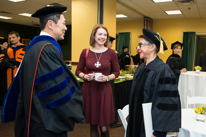 2016 Winter Graduation morning ceremony speaker Sheila C. Johnson, Co-Founder, BET; CEO, Salamander Hotels & Resorts, rght, speaks to Provost and Executive Vice President S. David Wu, and Beth Cabrera at the Fairfax Campus.  Photo by:  Ron Aira/Creative Services/George Mason University