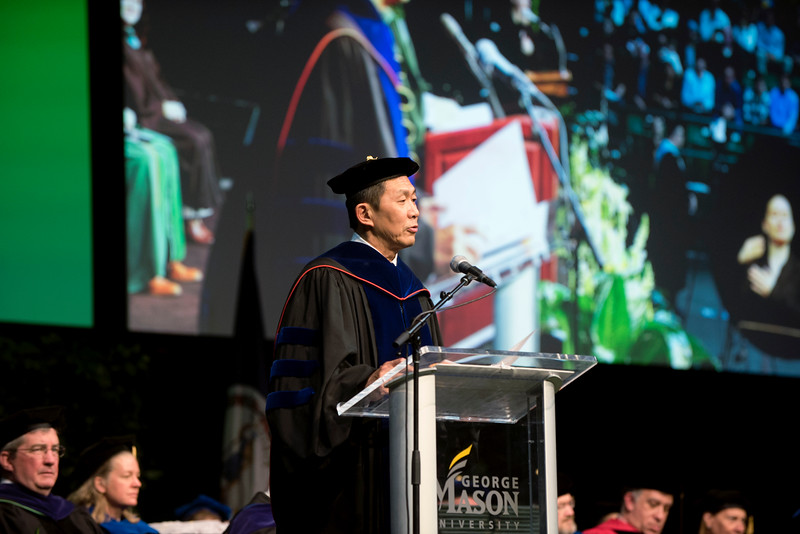 Provost and Executive Vice President S. David Wu presents the degrees to candidates during the 2018 Winter Graduation at the Fairfax Campus.  Photo by Bethany Camp/Creative Services/George Mason University