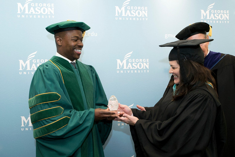 Drexel University Executive Vice President for Academic Affairs and Nina Henderson Provost M. Brian Blake and Alumni Association President Jennifer Shelton, BS Public Administration '94 at Winter Graduation 2018. Photo by Bethany Camp/Creative Services/George Mason University