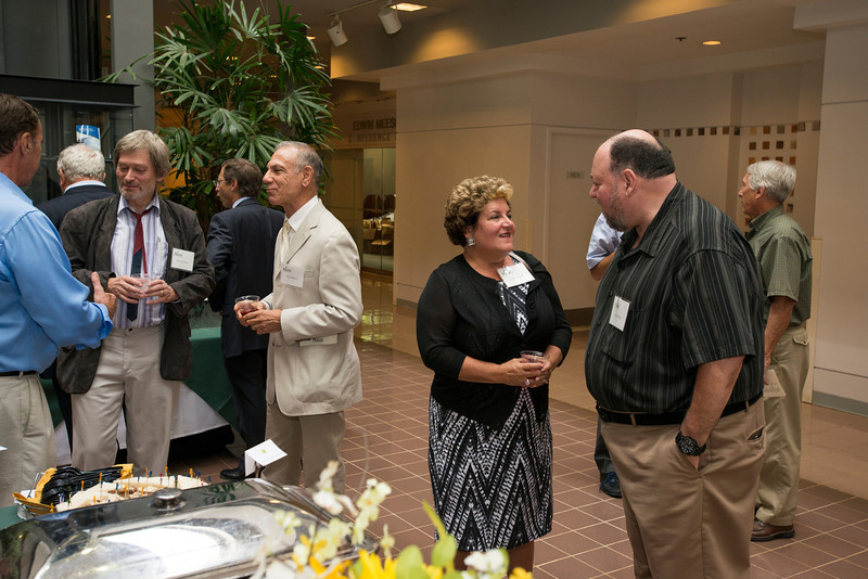 Professors attend the Distinguished Faculty Reception. Photo by Alexis Glenn/Creative Services/George Mason University