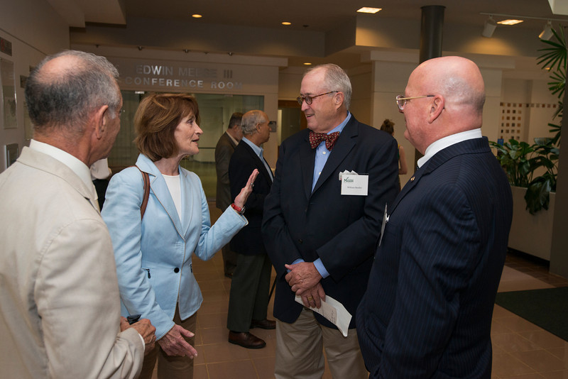 Linda Miller (2nd L) and CVPA Dean Bill Reeder (2nd R) attend the Distinguished Faculty Reception. Photo by Alexis Glenn/Creative Services/George Mason University