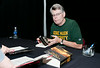 Author Stephen King signs books for fans at the Center for the Arts Concert Hall, Fairfax Campus during the 2011 Fall for the Book festival. Photo by Alexis Glenn