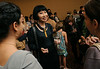 English graduate students talking to Amy Tan at a Fall for the Book reception.