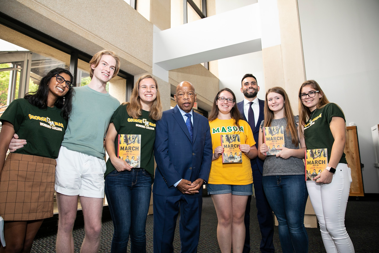 Honors College students pose for a photo with authors Lewis and Aydin at the Center for the Arts.