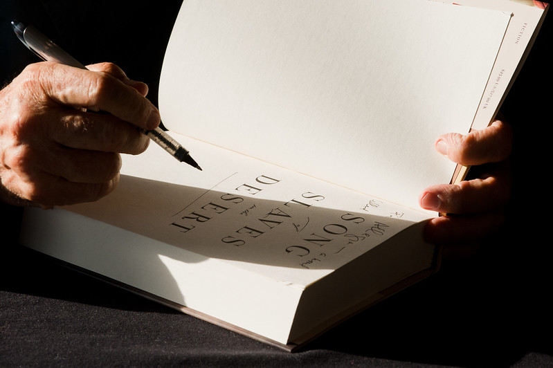 Novelist Alan Cheuse signs a copy of his book the 2011 Fall for the Book series at the Center for the Arts, Fairfax Campus