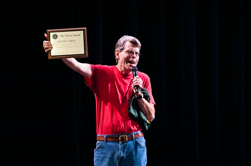 Author Stephen King holds up the Mason Award after he spoke at the Center for the Arts Concert Hall, Fairfax Campus during the 2011 Fall for the Book festival. Photo by Alexis Glenn
