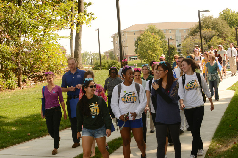 Students, faculty, and staff participate in the 4th annual Happy Heart Walk. The event sponsored by Wellness at Mason promotes preventive health screenings tand encourages healthy choices in general wellness and exercise. Photo by Evan Cantwell/Creative Services/George Mason University