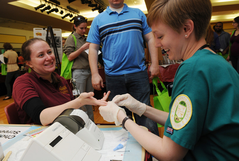 School of Nursing students perform free cholesterol screenings at the Health and Fitness Expo.  Photo by Evan Cantwell/Creative Services/George Mason University