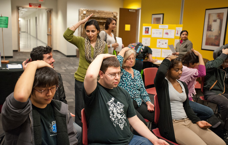 Students try sahaja meditation at the Health and Fitness Expo in Dewberry Hall on Fairfax Campus. Photo by Alexis Glenn/Creative Services/George Mason University