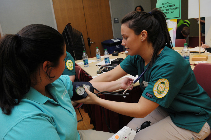 School of Nursing students perform blood pressure tests and screenings at the Health and Fitness Expo.  Photo by Evan Cantwell/Creative Services/George Mason University