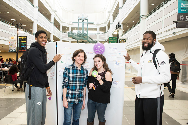 Mason students share what they're doing to share/spread happiness here at Mason and beyond at the Happiness Walls.  Photo by:  Ron Aira/Creative Services/George Mason University