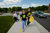 Participants of Wellness by Mason take the inaugural walk of the Yellow Birch Trail, a 1.6 miles walking trail that mirrors Patriot Circle at Fairfax Campus. Photo by Alexis Glenn/Creative Services/George Mason University