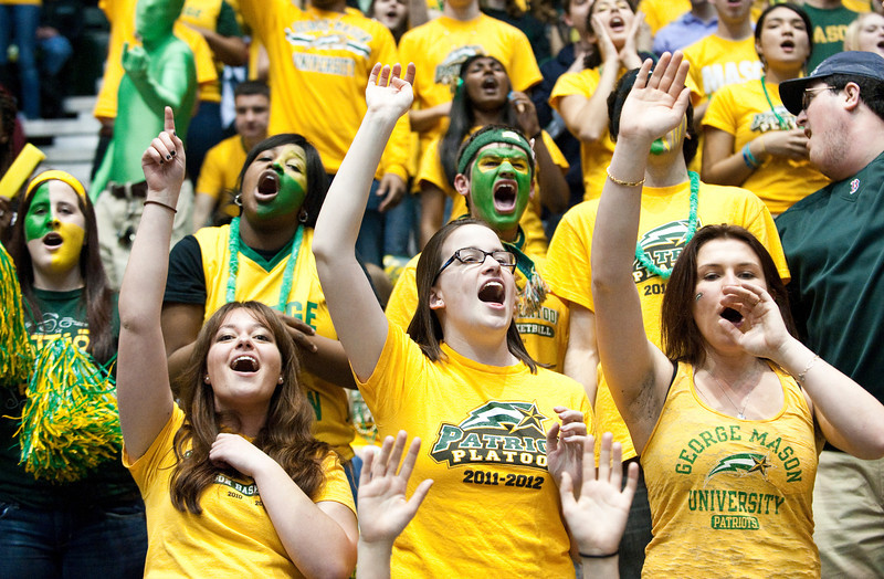 Students cheer during the Mason Homecoming 2012 basketball game at the Patriot Center, Fairfax Campus. Photo by Alexis Glenn/Creative Services/George Mason University